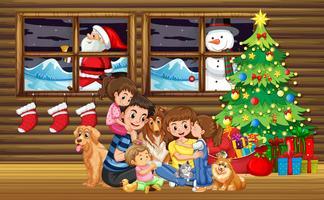 Noël en famille dans le salon avec arbre