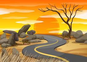 Scène avec route au coucher du soleil vecteur