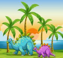 Dinosaures au coucher du soleil à la plage vecteur