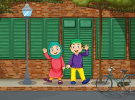 Couple musulman sur la route vecteur
