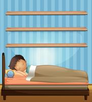 Garçon dormant dans la chambre