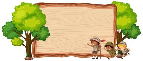 Camping enfants sur bannière en bois vecteur