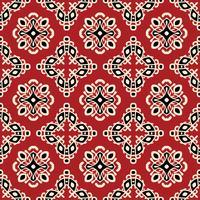 Modèle sans couture ethnique tribal rouge vecteur