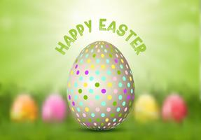 Oeuf de Pâques sur fond défocalisé