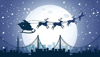 Silhouette Santa et renne volant le ciel de nuit