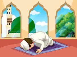 Un homme musulman prie à la mosquée