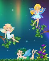 Trois fées volant dans le jardin la nuit vecteur