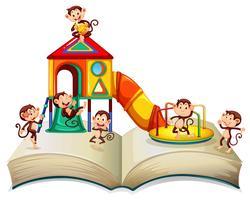 Singes jouant glissant sur le livre vecteur