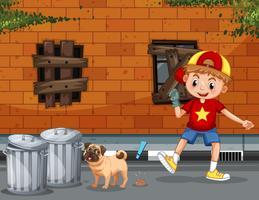Un garçon ramasser merde chien