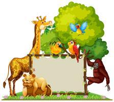 Animaux sauvages autour d'un cadre en bois