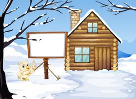 Chouette et cabane dans la neige