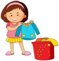 Petite fille faisant la lessive