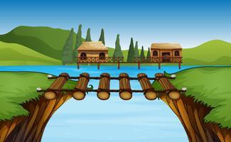 Scène avec deux cabanes au bord du lac