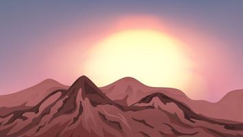 Scène avec des montagnes au coucher du soleil