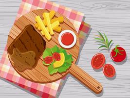 Steak et légumes sur une planche à découper vecteur