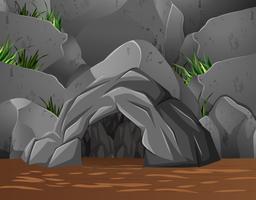 Scène de fond avec une grotte dans la montagne