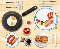 Set de petit déjeuner avec des œufs et des saucisses vecteur