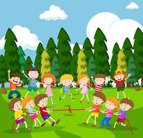 Scène de fond avec des enfants jouant au tir à la corde vecteur