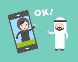 Communication d'un homme d'affaires arabe avec une femme d'affaires par téléphone portable vecteur
