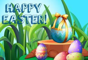 Joyeuses Pâques avec des oeufs décorés dans le jardin