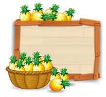 Ananas sur une planche de bois vecteur