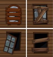 Fenêtres brisées sur un mur en bois