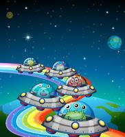 Aliens volant dans l'OVNI vecteur
