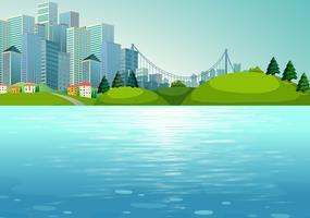 Scène avec bâtiments et rivière vecteur