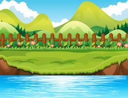 Scène de rivière avec fond de montagnes