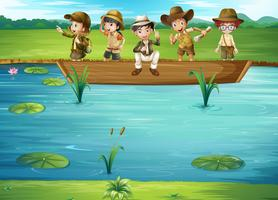 Enfants à cheval sur le bateau vecteur