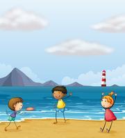 Enfants jouant au bord de la mer vecteur