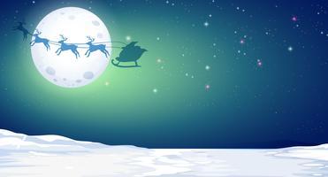 Silhouette de cerf et de père Noël dans la nuit d'hiver