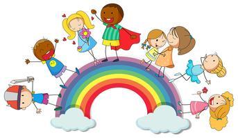 Enfants heureux debout sur l'arc-en-ciel