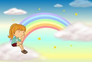 Une fille assise et un arc en ciel