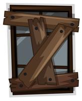 Vieille fenêtre clouée avec des planches