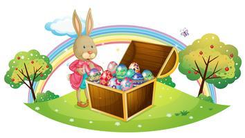 Un lapin avec beaucoup d'oeufs colorés