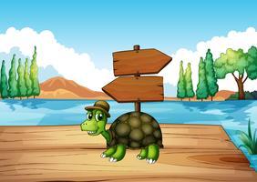 Une tortue sur le pont en bois avec un panneau vide vecteur
