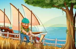 Un homme travailleur qui coupe du bois au bord de la rivière vecteur