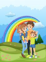 Une famille se promener avec un arc en ciel dans le ciel