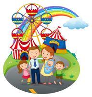 Une famille heureuse va au parc d'attractions vecteur