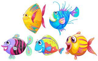 Un groupe de poissons souriants vecteur