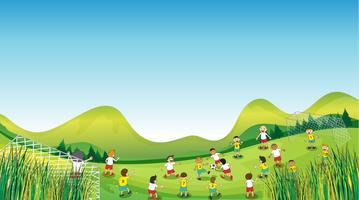 Enfants jouant au football vecteur