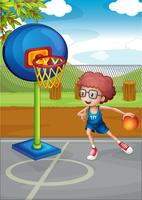 Un garçon jouant au basket