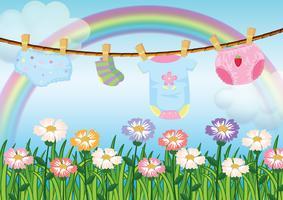 Un jardin avec des vêtements de bébé suspendus vecteur