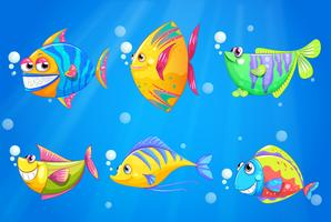Des poissons colorés et souriants sous la mer vecteur