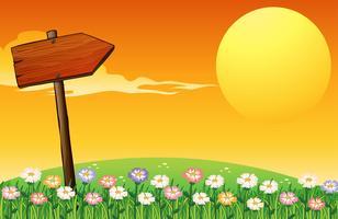 Un coucher de soleil avec une flèche en bois