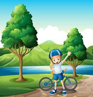 Une jeune motarde debout près de la rivière