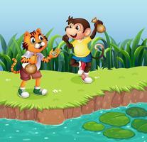 Un singe et un tigre jouant vecteur