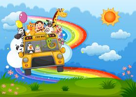 Un autobus de zoo au sommet d'une colline avec un arc-en-ciel dans le ciel