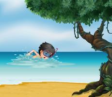 Un garçon nageant près d'un vieil arbre